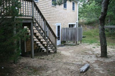 Back of house showing outside shower and rear entrance to porch