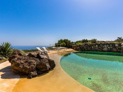Photo for Zighidì Bellavista - Beautiful Dammuso with amazing infinity pool and sunset view