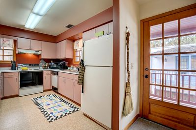 Fully-Equipped Kitchen with door to the back deck