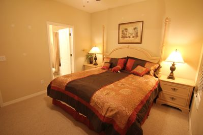 Upstairs master bedroom suite with a king bed and Crib for a baby