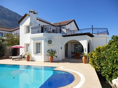 Luxury villa and private pool with spectacular mountain background and sea views