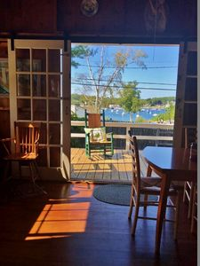 Sliding french doors with screens open to front deckoff of living/dining room