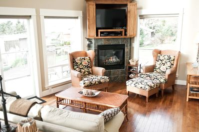 Main floor living room has a gas fireplace, flat screen TV and a DVD player.