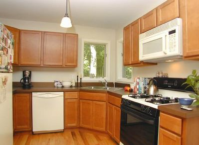 Fully equipped kitchen with gas stovetop, microwave, dishwasher