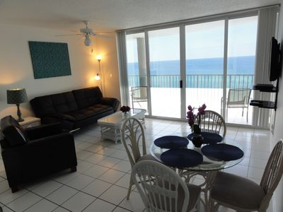 Living and dining room! Floor to ceiling sliding glass doors & access to balcony