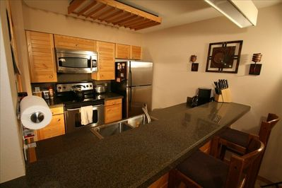 Well appointed kitchen with granite counters and new appliances