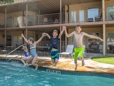 Photo for Waterwheel Condo- River/Pools, Less than 1 Mile from Schlitterbahn!
