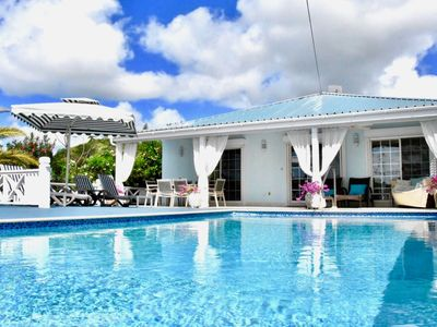 Modern & Stylish 4 Bedroomed Villa, private pool, walking distance to beach.