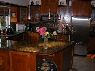 Custom kitchen, wine frig, all cutlery, silverware and cookware included.