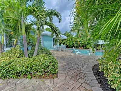 Photo for Dog-friendly, tropical house with a private, heated pool - walk to the beach!