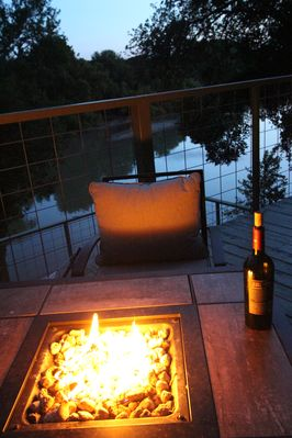 Enjoy the beautiful river flow from the 3 decks with 2 gas fire pits.  BYO Wine!