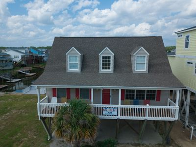 """Photo for NEW on the PROACTIVE Vacations rental market, """"Amuse Me"""" offers wonderful water views of the canal and an easy stroll to the beach & the Holden Beach Fishing Pier! Location! Location! Location!"""