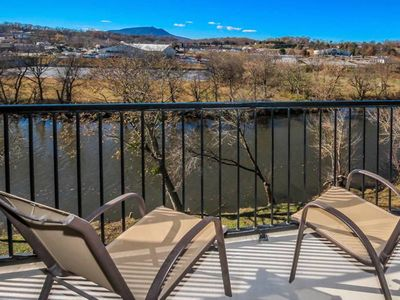 Photo for Riverfront condo w/ balcony & shared pool/hot tub - close to Pigeon Forge!