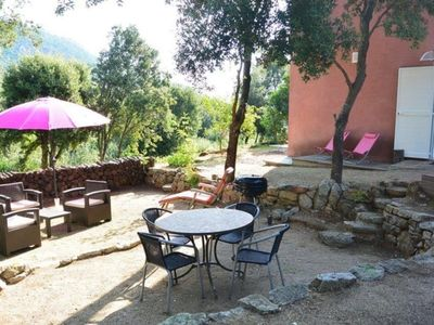 Photo for Nice apartment in a typical Corsican village with garden and mountain view