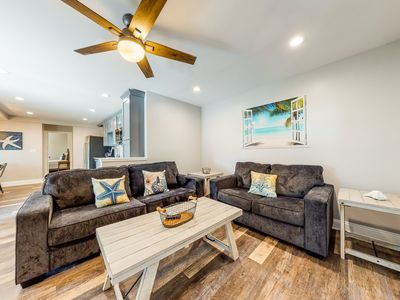 Photo for Waterfront apartment w/ a furnished deck & free WiFi - walk to the beach!