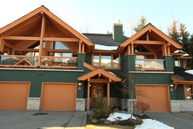 Entry. Deck over single car garage offers spectacular views.  BBQ on deck.