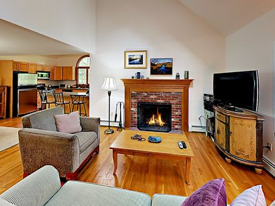 "Living Room - Get cozy by the wood-burning fireplace while you watch a movie on the 42"" flat-screen TV."