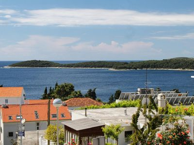 Photo for Two bedroom apartment with terrace and sea view Hvar (A-5719-b)
