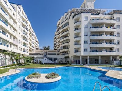 Photo for Beachfront apartment with communal pool