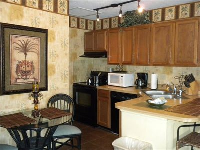 Full size appliances in kitchen! Spacious dinning with good cookware and dishes.