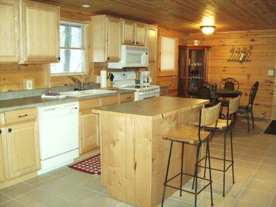 Photo for Cozy Log Cabin Home nestled in the woods but close to everything!