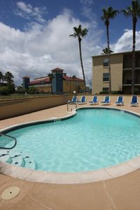 Photo for 2 Br S Padre Condo W/Pool - Short Walk To Beach, Dining & Shopping.