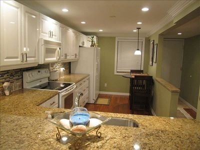 Updated kitchen with granite counters, Bamboo floors, bistro seating.