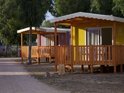 Photo for Tidy chalet in a park with many facilities a stone's throw from the sea