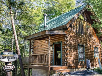 Photo for Cozy cabin with hot tub, wrap-around porch, fireplace, and free passes to local attractions