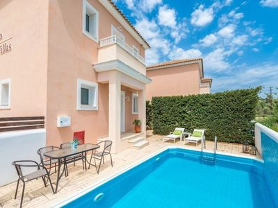 Photo for Set in the beautiful resort of Agios Sostis Villa Amethyst is a two bedroom split level villa that c