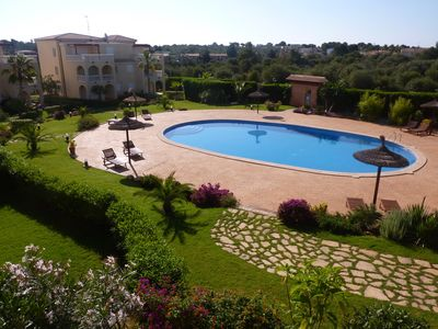 Photo for Quiet beach apartment fully equipped, with pool, gardens and WIFI