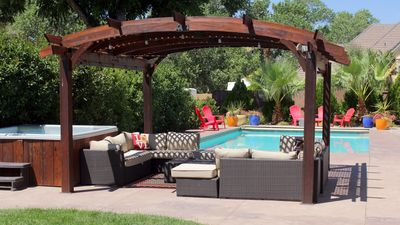 The pergola has plenty of seating to keep an eye on the kids in the pool