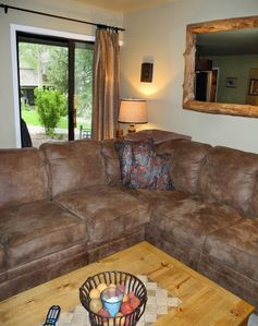 New sofa and looking out sliding doors to deck.