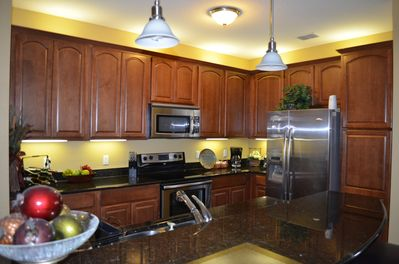 Fully equipped kitchen with marble counters and stainless steel appliances