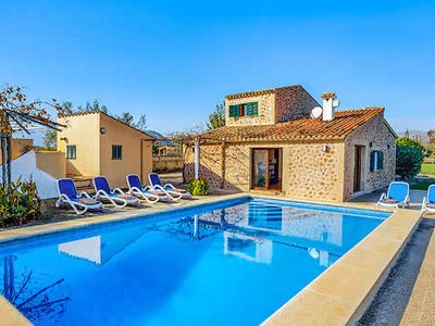 Photo for Lovely villa with pool, pretty gardens, and all modern amenities, short drive from beaches and town