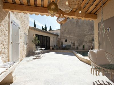 Photo for Architect house in provencal village center with heated pool