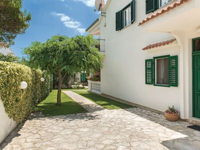 Photo for Lovely 4 bedroom apartment with beautiful garden and terrace, 50m from the beach