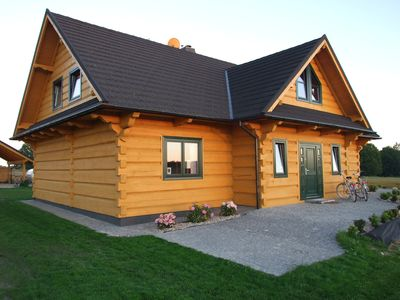 Photo for Idyllic luxury wooden house with large garden in the middle of nature, with sauna