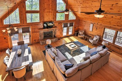 The living room boasts a 50-inch flat screen TV and a gorgeous stone fireplace.