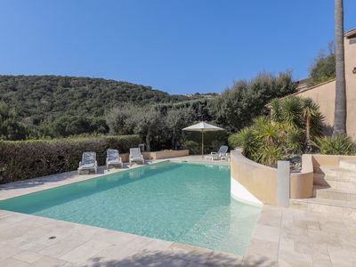 Photo for Pretty Provencal farmhouse with sea view and wooded hills environment, swimming pool