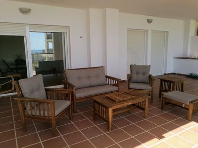 Photo for Apartment near the beach with large terrace in Torre de Benagalbón.