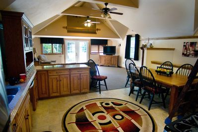 kitchen and dining area, with loft above.