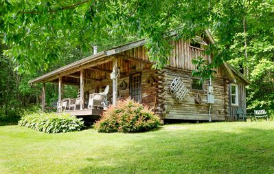 Photo for Charming Log Cabin on Private Pond Nestled in Woods.