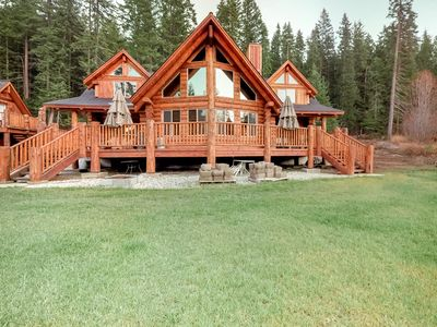Photo for NEW LISTING! Luxury log home & carriage house w/fireplace & deck.