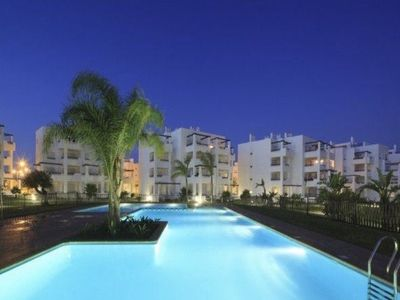 Photo for LUXURIOUS 3 BED, 2 BATH PENTHOUSE APARTMENT OVERLOOKING GOLF COURSE & POOL!