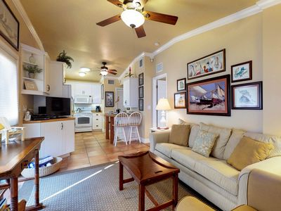 Photo for Elegant condo w/ patio & shared heated pool - one block to the beach/trolley!
