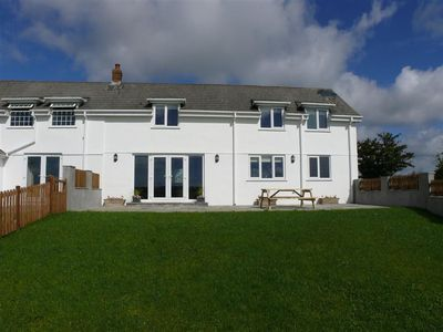 Photo for One of three charming holiday cottages in a rural setting with some lovely walks on the doorstep. Ll