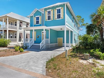 Photo for Elegant coastal home w/ ample porch space & shared pool - walk to beach!