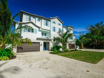Photo for CANAL FRONT, 6 BED 5.5 BATH HOME - SLEEPS 17 in BEDs - Kayak and Paddleboard Included. Shared Dock. Bring Your Boat. Private Heated Pool and Spa. Walk to Beach and Village. Property Manager Program