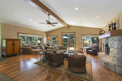 Open floor great room w/wood burning fireplace leading to 1000' wrap around deck